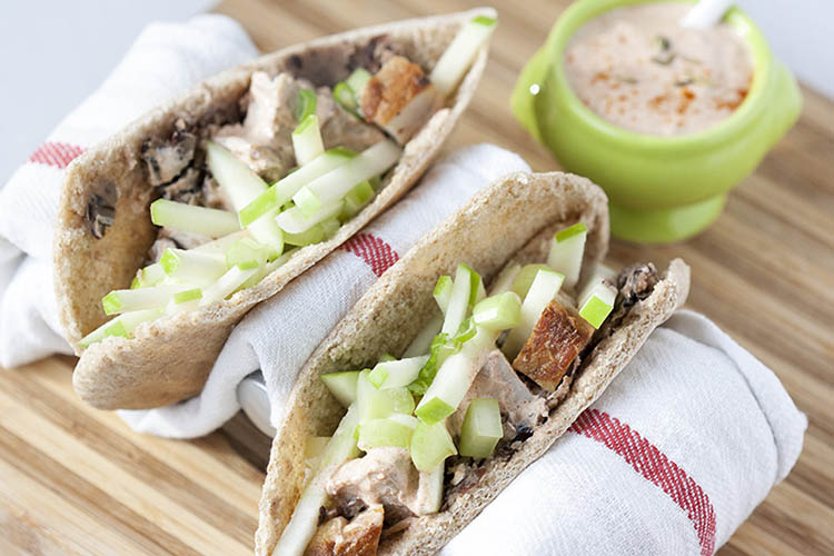 Pork pita with fried black beans and apple celery slaw